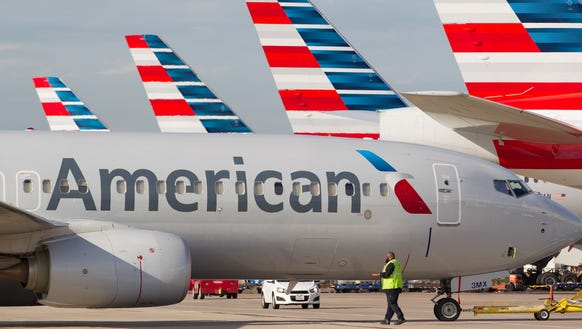American Airlines jets sit ready for departure from