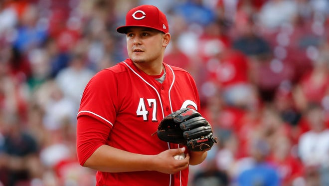 Cincinnati Reds starting pitcher Sal Romano prepares to throw in the eighth inning of a baseball game against the Pittsburgh Pirates, Saturday, Sept. 16, 2017, in Cincinnati.