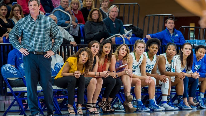 FGCU women's basketball coach Karl Smesko's homegrown staff includes assistant Chelsea Lyles (seated first on left), video coordinator Stephanie Haas (second), Amanda Pierce (third), the director of basketball operations, assistant Jenna Cobb (fourth) and assistant/associate head coach Chelsea Banbury (eighth).