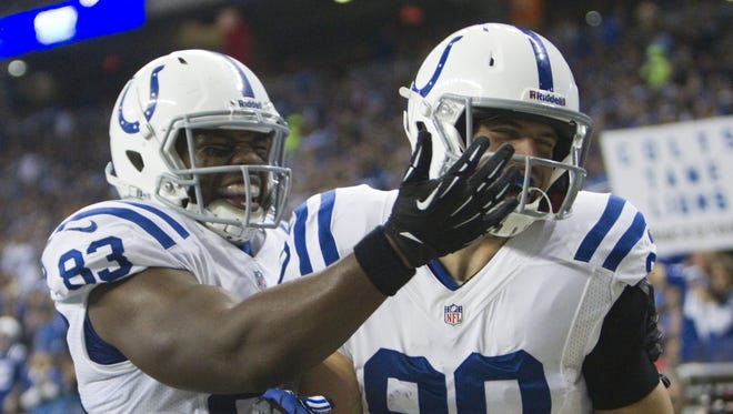 FILE -- Dwayne Allen (left) of the Colts, congratulates teammate Coby Fleener after his touchdown in the first quarter, Indianapolis Colts vs. Detroit Lions, Ford Field, Detroit, Sunday, December 2, 2012. Robert Scheer/The Star