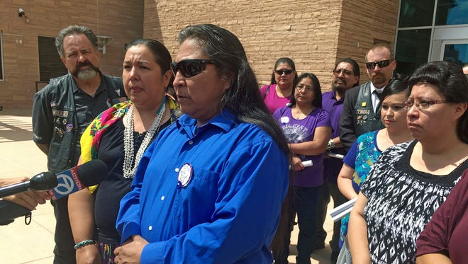 In this Aug. 1, 2017, file photo, Gary Mike, front, father of 11-year-old Ashlynne Mike, speaks outside of federal court in Albuquerque, N.M., after the man charged with her murder and sexual assault pleaded guilty. The death of Ashlynne Mike on the largest American Indian reservation prompted calls to expand the Amber Alert system and the death penalty to tribal communities across the U.S. Recent cases of horrific child killings, attacks on law enforcement officers and an overall rise in crime has some conservative New Mexico lawmakers calling for the state to consider reinstating a narrow version of the death penalty.
