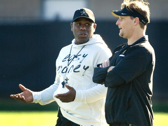 Vanderbilt coach Derek Mason talks with new defensive coordinator Jason Tarver during the Commodores' first practice of spring on Monday.