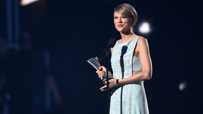 Taylor Swift accepts the milestone award at the 50th annual Academy of Country Music Awards at AT&T Stadium on Sunday, April 19, 2015, in Arlington, Texas.