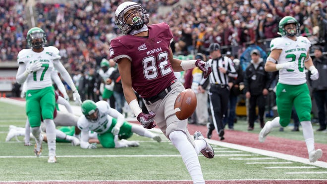 Montana wide receiver Samori Toure (82) scores a touchdown against North Dakota in an NCAA college football game, Saturday, Oct. 14, 2017, in Missoula, Mont. (AP Photo/Patrick Record)