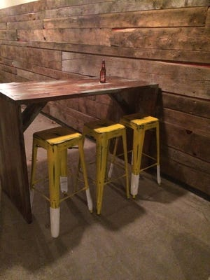 The back bar at the new Antojitos Mexicanos will have a rustic look with barn boards and antiqued stools.