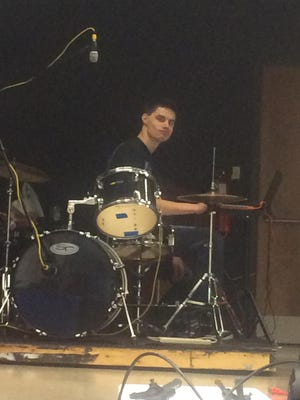 Steven Perry plays the drums during rehearsal for the Freedom's Got Talent show, opening Thursday at Freedom High School.