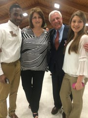 Carolyn Lang (left middle) stands with 4-H member Stephon Wilson (left), Attorney General Buddy Caldwell (right middle) and granddaughter Caroline Whisonant at a 4-H event.