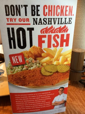 Table displays tout the new Nashville Hot Fish at a Captain D's on Highway 70 in Bellevue.