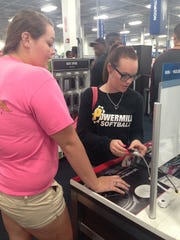 Kaelee (left) and Bre Hill browse the electronics section of Best Buy on Friday.