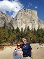"""Jan and Ken Fuhrman of Troy visited Yosemite National Park on a trip to California in October. They are standing in front of the rock formation called """"El Capitan""""."""