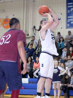 Silver's Garrett Laney pulls up for a jumper during action against Deming on Tuesday. He led the Colts with 20 points, including hitting the game winner with four seconds to play.