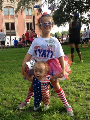 Wyatt Stapleton and sister Zooey Cajote at a previous Firecracker 5k.