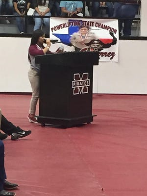 Mathis junior and powerlifter Lexus Gutierrez speaks to a crowd at a pep rally honoring her state championship in powerlifting earlier this spring.