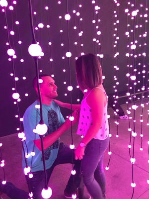 """Chris Koehne proposes to Tracie Agustin inside """"Ocean of Light: Submergence"""" at the Scottsdale Museum of Contemporary Art on June 23, 2017."""