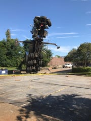 A crane collapsed Monday in downtown Anderson