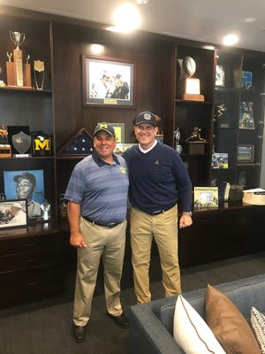 Retired Bloomfield Township fire chief Dave Piche now works for University of Michigan football coach Jim Harbaugh.