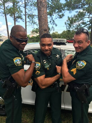 """Leon County Sheriff's Office """"45 and fine"""" crew poses in photos to get in on the """"hot cop"""" social media craze."""