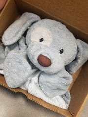 After confirming who was the lost stuffed animal's owner was, Katie Hoeppner, 34, of Marion boxed Pup Pup and put him in the mail to go home on Thursday, Oct. 5, 2017.