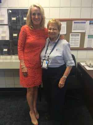 Legendary tennis official Woodie Sublett Walker stands alongside former women's tennis sensation Tracy Austin