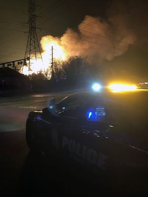 Flames arise Monday< Nov. 20, 2017 at the site of a natural gas pipeline eruption in Orion Township.