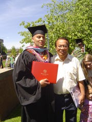 Rait Sonis, right, poses for a picture with his son,