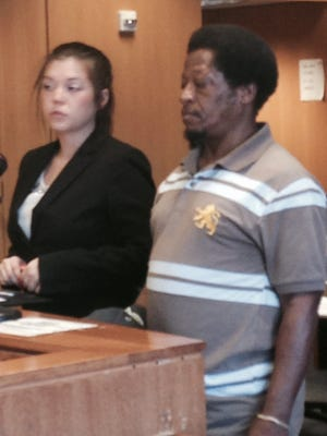 Pamela M. Sossi, attorney for Derrick Felton, right , the owner of the dogs that nearly killed Steve Constantine on Detroit's east side last year stands before Judge Ronald Giles who postpones the preliminary exam until April 8.