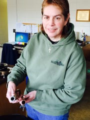 Utility Resources Manager Deb Geier shows a lead pipe and a copper pipe at the Wausau Water Works offices in Wausau on March 13, 2015.