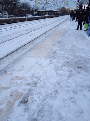 The Metro-North train station platform is iced over in Pelham on Tuesday morning.
