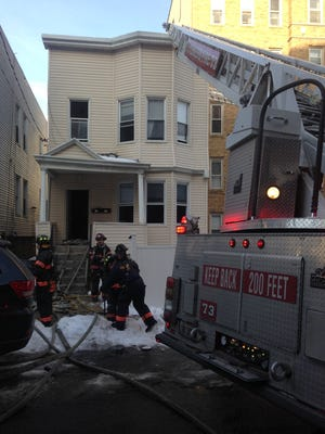 Yonkers firefighters extinguish a fire at 104 Glen Road on Wednesday.