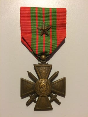The Croix de Guerre is a French military decoration commonly awarded to allies of France during World War I and II. A letter indicates it had been awarded to William H. Billman, who lived in Zanesville in 1946.
