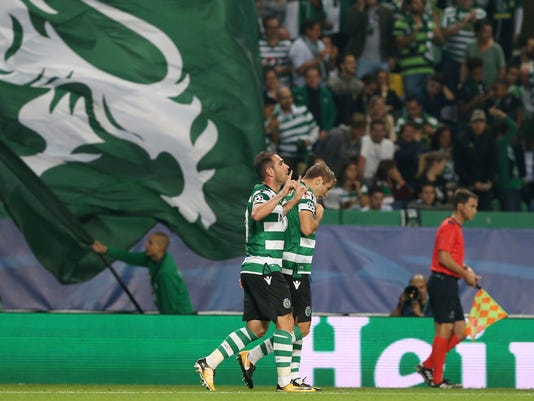 Sporting's Bruno Cesar, left, celebrates after scoring his side's opening goal during a Champions League, Group D, soccer match between Sporting CP and Juventus at the Alvalade stadium in Lisbon, Tuesday, Oct. 31, 2017. (AP Photo/Armando Franca)
