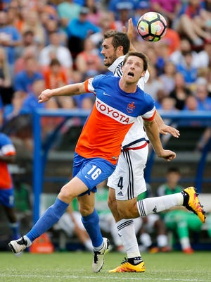 FC Cincinnati's Daryl Fordyce tries to gain possession over Bethlehem Steel FC's Ken Tribbett in the first half at Nippert Stadium Saturday May 20, 2017.