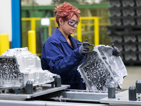 Dzenana Hadziosmanovic inspects a transmission case for a Ford pickup truck at Nemak, an automobile industry supplier that manufactures die-cast aluminum parts in Sheboygan.