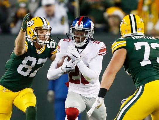 New York Giants' Janoris Jenkins runs back his interception