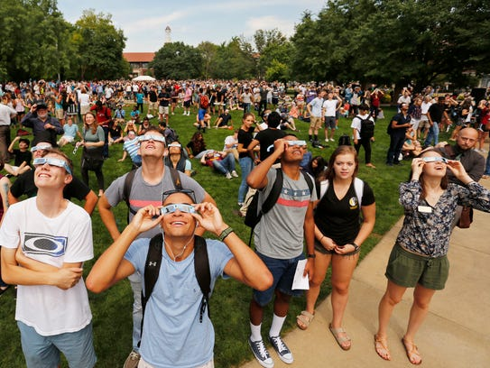 A  large crowd gathers in the Purdue Memorial Mall