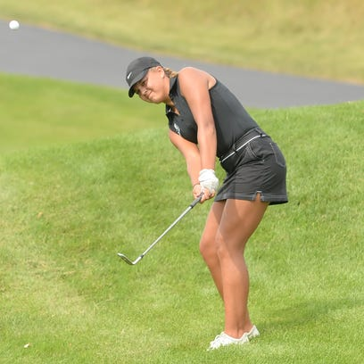 Franklin's Faith Krause chips her way onto the green at a recent meet. She helped the Sabers earn their third straight Southeast Conference title on Sept. 22.