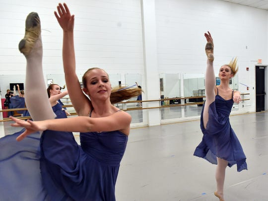 """Ballet Mississippi dancer Ruth Ann Richardson, left, and Camille Grady perform during a rehearsal of """"Let The Music Dance,"""" which they will be performing with musician Claire Holley Saturday at Duling Hall in Jackson."""