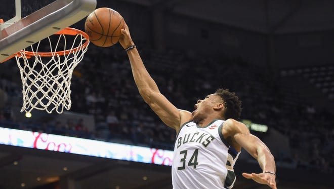 Bucks forward Giannis Antetokounmpo scores a basket in the second quarter against the Atlanta Hawks.