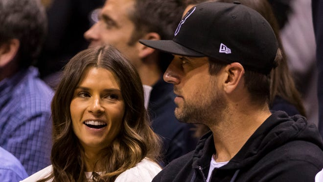 Danica Patrick and Aaron Rodgers look on during the first quarter of Game 3 between the Boston Celtics and Milwaukee Bucks.