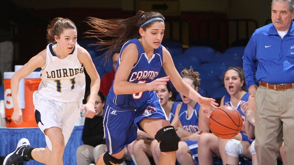 Carmel's Alyssa D'Apice (5) steals the ball away from Lourdes' Emily Ferreri (11) during the girls basketball Class AA Section 1 semifinal at the Westchester County Center in White Plains on Mar. 1, 2012.