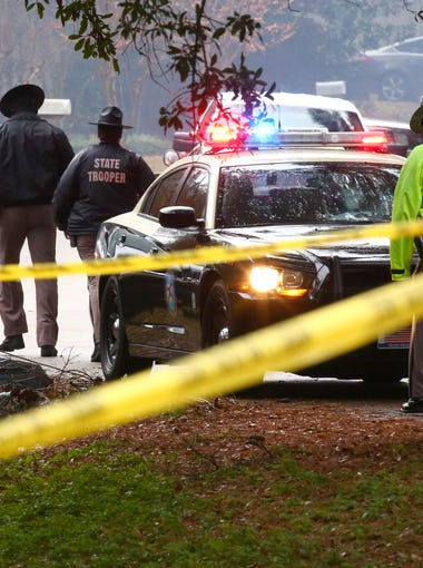 Joe Rondone/DemocratFlorida Department of Law Enforcement on the scene of an officer involved shooting on Caracus Court and Carnwath Road in Tallahassee Saturday Nov. 22, 2014.