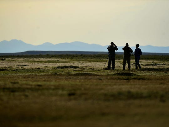 Visitors to the American Prairie Reserve scan the horizon at one of the prairie dog towns in 2015.