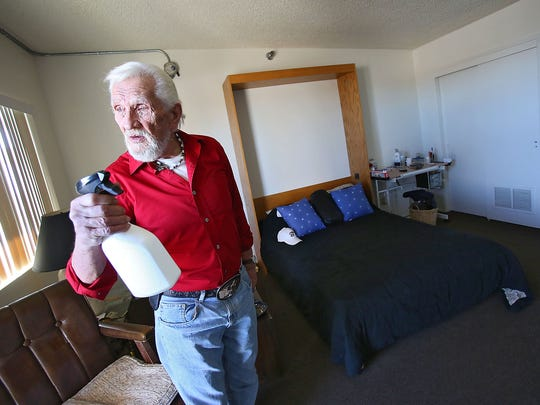 Alex Blume says he uses a bottle of alcohol to kill the bed bugs that have infested the Linda Vista Senior Residences in Desert Hot Springs.