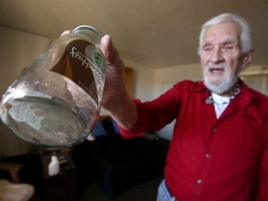 Alex Blume who lives at Linda Vista Senior Residences keeps a bottle with bed bugs as proof they have infested his apartment.