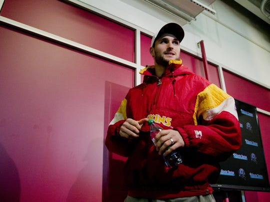 Former MSU QB Kirk Cousins sports an old-school Redskins Starter jacket. Carl Banks, who also played for the Redskins, has re-branded the Starter sports apparel line through his company, G-III Sports by Carl Banks.