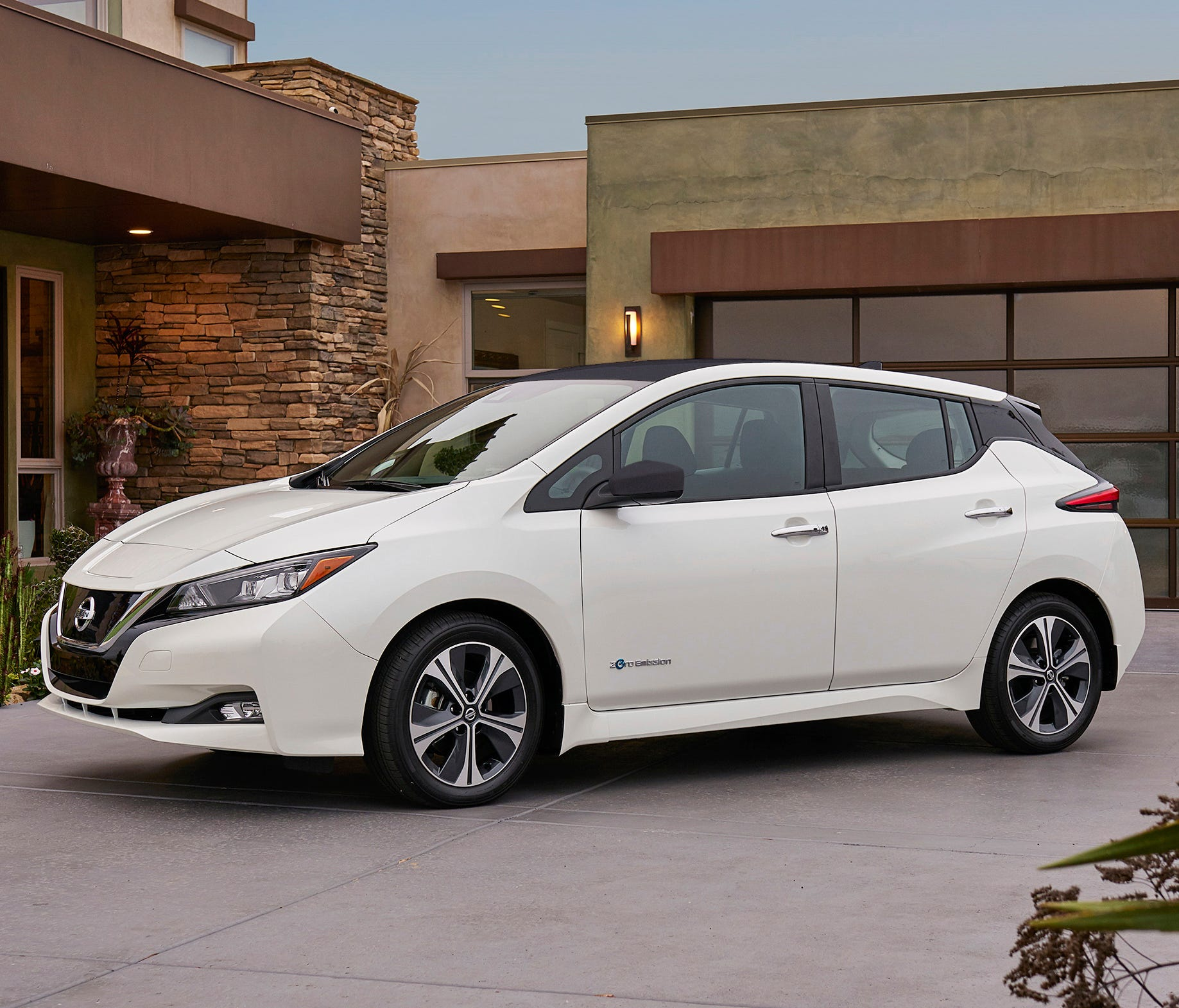 This photo provided by Nissan shows the 2018 Nissan Leaf, a redesigned version of one of the most popular electric vehicles ever produced. It goes on sale in early 2018, with a starting price just under $31,000.