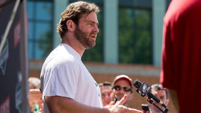 Philadelphia Eagles guard Evan Mathis speaks with members of the media at NFL football training camp Friday, July 25, 2014, in Philadelphia.