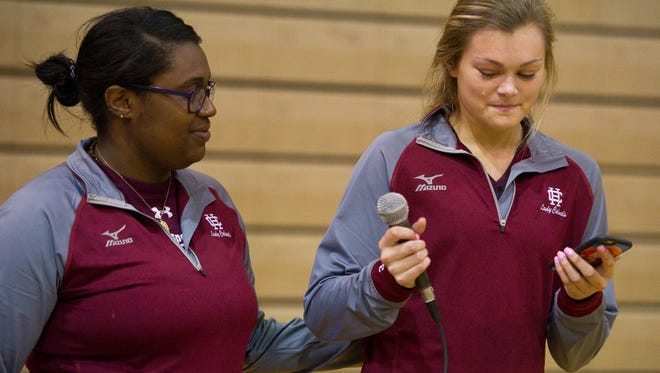 Henderson County volleyball head coach Ashley Sallee-Robinson comforts player Hannah Watkins as she reads a poem about the late Jerry Mezur, a former coach and athletic director for the Colonels, during the Jerry Mezur Spikefest at the school on Oct. 8.