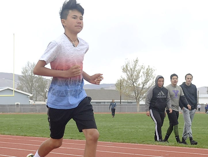Kutoven Stevens practices with the high school track