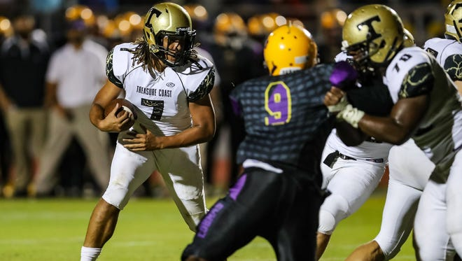 Treasure Coast High School's quarterback, Sean Birchfield, evades a sack during the Sept. 30 game agains Fort Pierce Central at Lawnwood Stadium in Fort Pierce.
